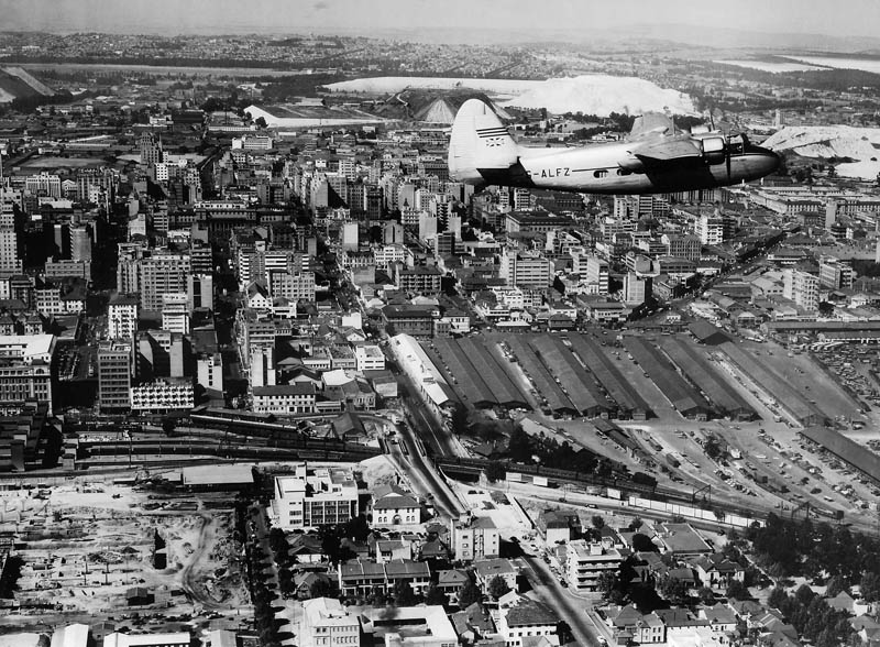 An aerial view of Johannesburg in the late 1940s shows a prosperous young city fed by gold mining. It doesn't show the daily suffering and indignity of the black labour needed to mine the gold. (SA Ports and Railways Archive / View from Above)