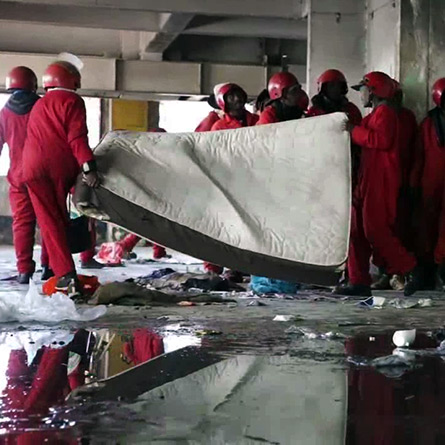 Red ants remove people's belongings during a mass eviction at Fatti Mansions in Hillbow, Johannesburg in July 2017. (YouTube)