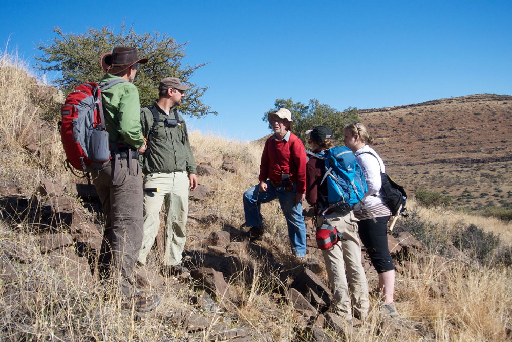 In search of ancient bacteria ... The scientists on a 2014 excursion to collect fossils near the town of Kuruman in South Africa's Northern Cape province. From left: Clark Johnson, University of Wisconsin, Madison; Aaron Satkoski, University of Wisconsin, Madison; Nicolas Beukes, University of Johannesburg, South Africa; Breana Hashman, University of Wisconsin, Madison; and Kira Lorber, University of Cincinnati. (Image: Andrew Czaja, University of Cincinnati)