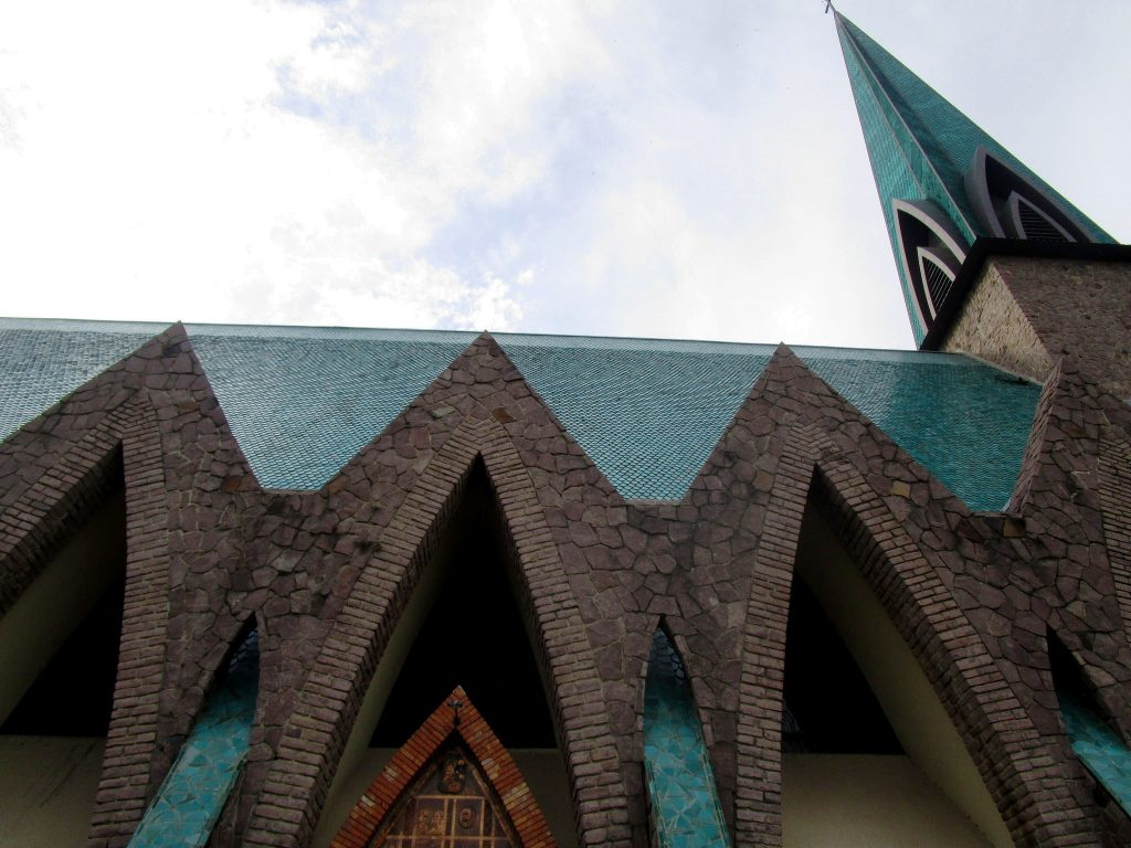 The Basilica of Saint Anne in Brazzaville, the capital of the Republic of the Congo, is a Catholic church built in the 1940s using a mix of European and African design styles. The vast green-tiled building is 85 metres long, with a transept 45 metres wide and a 22-metre-high arch. (Photo © Tom Robertson)