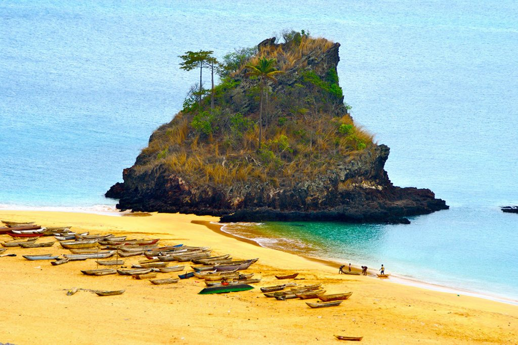 Africa - Fishing boats, beach and rock formation on Annobón Island, Equatorial Guinea
