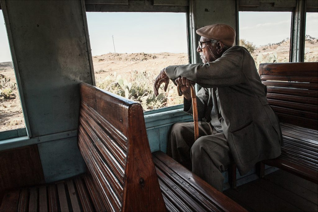 Africa - A man looks out from a carriage on the Eritrean railway line between the capital of Asmara and the coastal city of Massawa