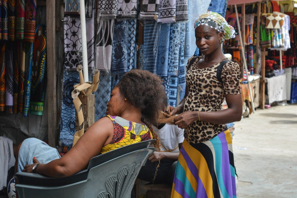 Africa - Hair braiding at Makola Market in Accra, the capital of Ghana