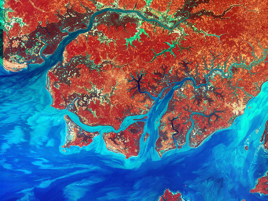 A false-colour composite satellite image of the rivers, coast and islands of Guinea-Bissau. Infrared, red and blue light wavelengths bring out details of the complex patterns of the country's shallow coastal waters, where silt carried by the Geba and other rivers washes out into the Atlantic Ocean.