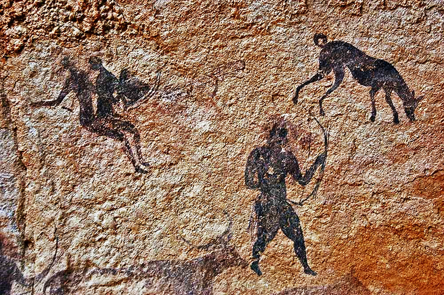 Rock art in Algeria's Tassili n'Ajjer plateau has been dated at seven to 10 thousand years before present. The dog at the top right of this hunting scene shows typical Africanis traits – long snout, pointed ears, elegant build and curled-up tail. (Alberto Bertelli)