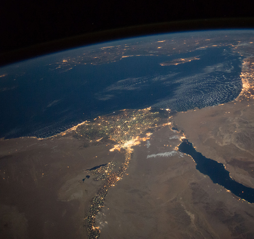 ISS049e004516 (09/16/2016) --- This nighttime view of northern Egypt and the Sinai Peninsula was captured by the Expedition 49 crew aboard the International Space Station. The city of Cairo can be seen to the left at the top of the Nile river. Atop the sparsely lit Sinai Peninsula can be seen cities in Israel, including the brightly lit city of Tel Aviv on the Israeli coast along the Mediterranean sea.