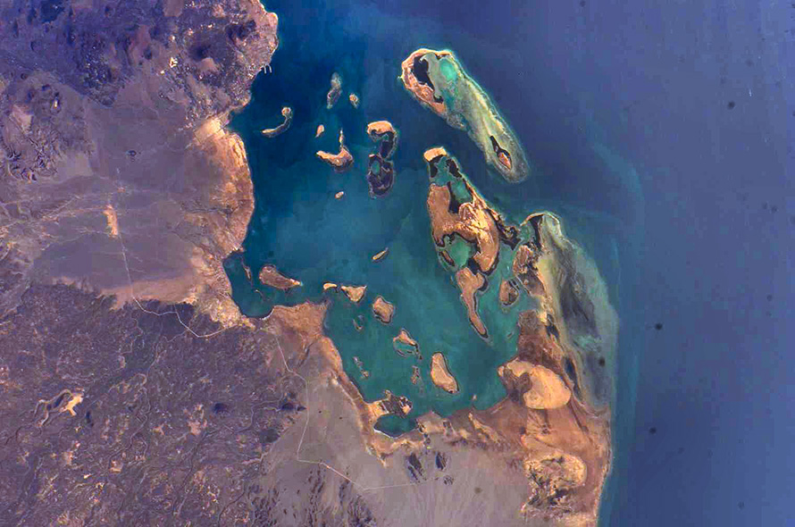 Islands and coral reefs on the Red Sea coast of Eritrea, a small country in eastern North Africa, in an image taken by a crewmember aboard the International Space Station during Expedition 13, in April 2006. (Nasa, CC BY-NC 2.0)