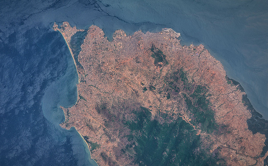 Freetown, an important West African port city and the capital of Sierra Leone, captured by Sentinel 2A satellite on 28 March 2016. Its harbour, the centre of the city's economy, lies in the estuary of the Sierra Leone River and is one of the largest natural deep water harbours in the world. The city of Freetown was founded in 1792 by freed African-American slaves. (Antti Lipponen, CC BY 2.0)