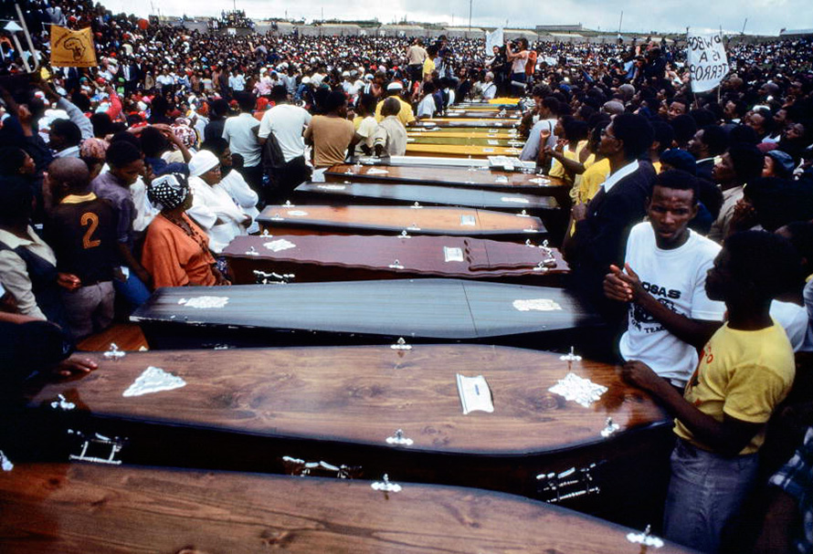 The coffins of those slain in the Langa Massacre of 21 March 1985. Twenty-five years to the day after the infamous Sharpeville Massacre, in which 69 people were killed, police opened fire on a crowd of people on their way to attend a funeral in Langa, Uitenhage, in the Eastern Cape. At least 20 people were killed. (UN Photo, CC BY-NC-ND)
