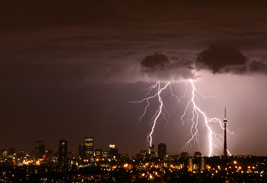 The clouds and lightning of a summertime thunderstorm over Johannesburg. The Brixton Tower is at right, and the buildings of the city's old central business district towards the left. (Derek Keats, CC BY 2.0)