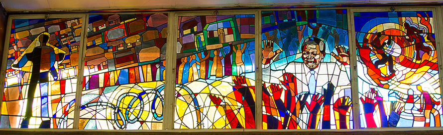 Stained glass in the famous Regina Mundi Church in Soweto shows scenes from the township's - and South Africa's - liberation history. (Willem van Valkenburg, CC BY 2.0)