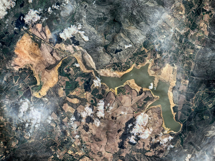 A satellite image of Cape Town's Theewaterskloof Dam in early February 2018 shows the seriousness of the city's drought. After three successive dry years - estimated as a once in a millennium event - the dam, which supplies half the city's water, was at only 13% capacity. (Antti Lipponen, CC BY 2.0)