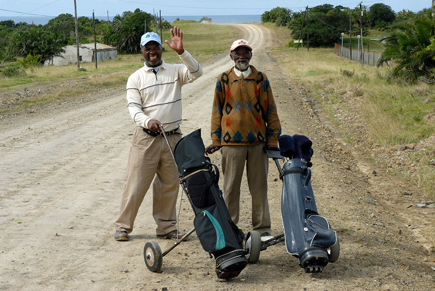 Avid golfers Welcome Tolbadi (18 handicap) and Dickson Mboyi (10 handicap) head off for a round at the nine-hole golf course in the Wild Coast village of Qolora Mouth in the Eastern Cape. (Rodger Bosch, Media Club South Africa)