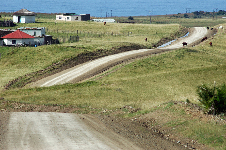 The road into the coastal village of Qolora Mouth curves past rural homesteads in the Wild Coast region of the Eastern Cape. (Rodger Bosch, Media Club South Africa)
