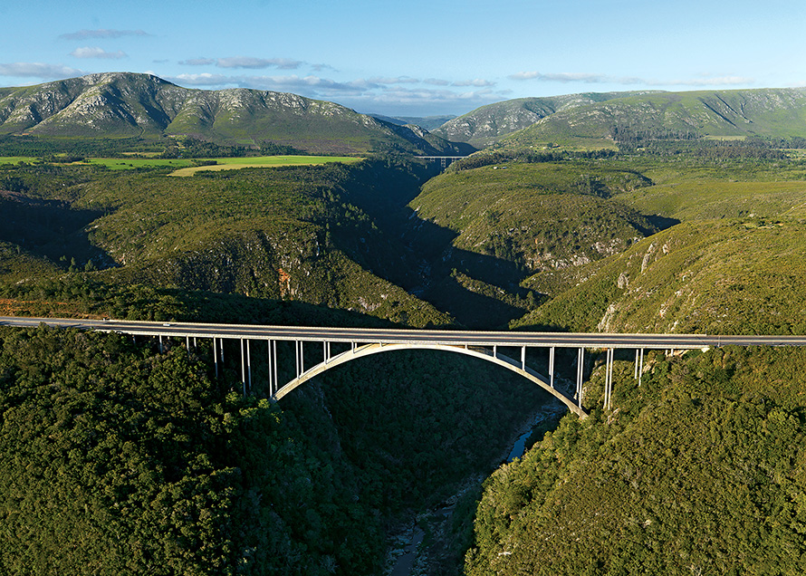 The Storms River Bridge in the Tsitsikamma region of the Eastern Cape, with the Baviaanskloof Mountains in the distance. (Rodger Bosch, Media Club South Africa)