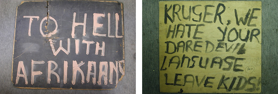 Two of the many placards produced by students during the uprising (confiscated and photographed by the police) highlight their antagonism to Afrikaans. The placards were written in English, the students' second language. (Doing Violence to Memory: The Soweto Uprising)
